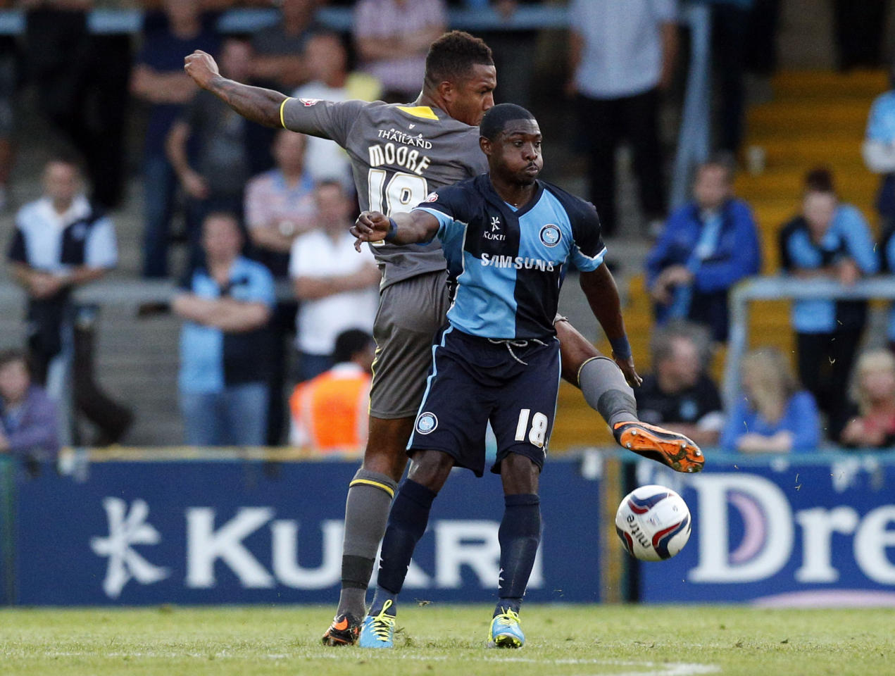 Wycombe's Jo Kuffour (right) tussles with Leicester City's Liam Moore during the Capital One Cup, First Round match at Adams Park, Wycombe.