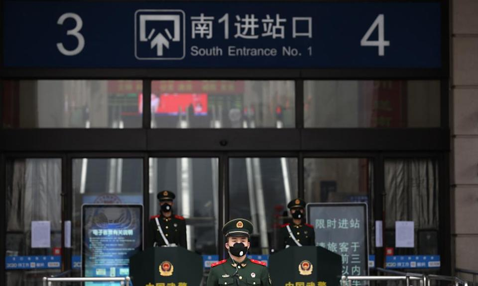 Armed police outside the closed Hankou railway station in Wuhan.