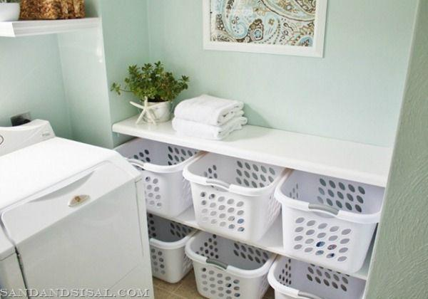 """<p>Under her folding table, this home blogger placed a basket for each member of her family. She sorts the laundry into each person's bin, and they're required to fold and put it away. Three cheers for delegating (err, teamwork?).</p><p><a href=""""http://sandandsisal.com/2012/05/laundry-room-makeover.html"""" rel=""""nofollow noopener"""" target=""""_blank"""" data-ylk=""""slk:Read more at Sand and Sisal »"""" class=""""link rapid-noclick-resp""""><em>Read more at Sand and Sisal »</em></a></p>"""