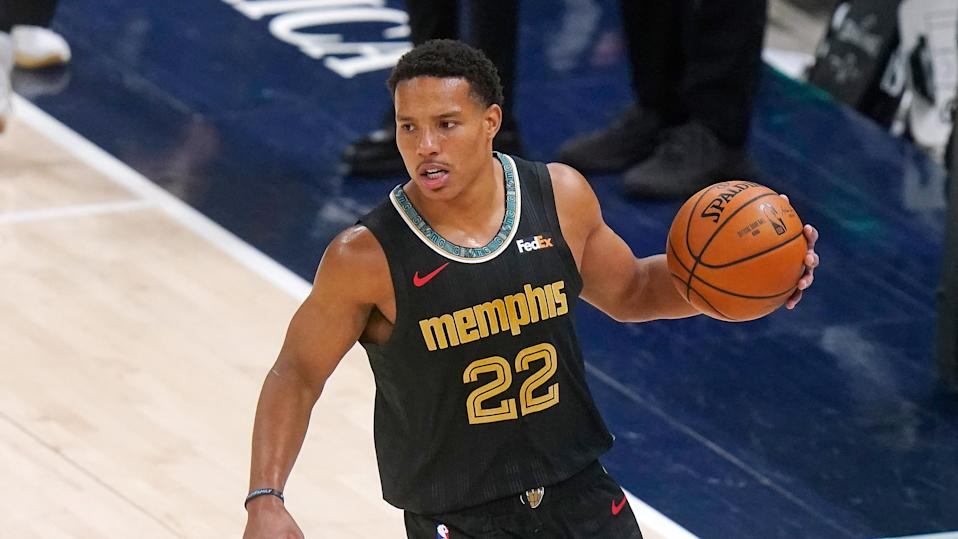 Memphis Grizzlies guard Desmond Bane (22) brings the ball up court in the second half during an NBA basketball game against the Utah Jazz Saturday, March 27, 2021, in Salt Lake City.