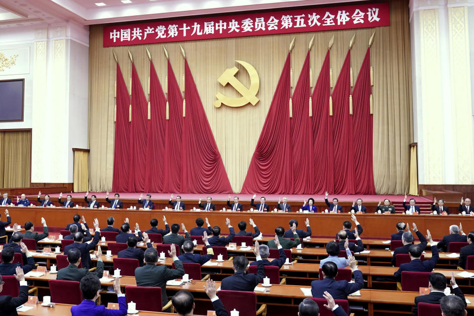 "In this photo released by Xinhua News Agency, the Political Bureau of the Communist Party of China (CPC) Central Committee presides over the fifth plenary session of the 19th CPC Central Committee in Beijing, China on Oct 29, 2020. China's leaders are vowing to make their country a self-reliant ""technology power"" after a meeting to draft a development blueprint for the state-dominated economy over the next five years. (Yin Bogu/Xinhua via AP)"