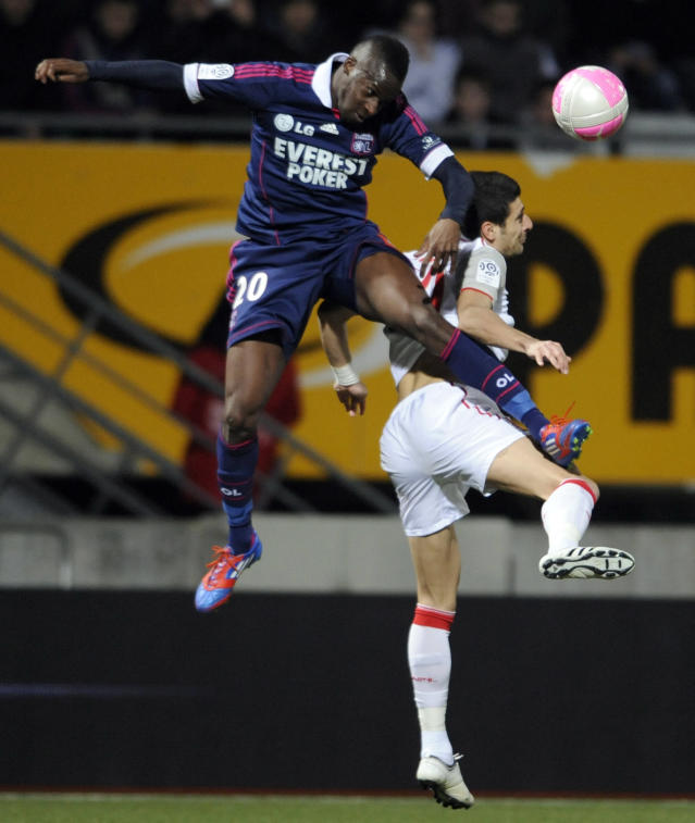 Nancy's Romanian forward Daniel Niculae (R) fights for the ball with Lyon's French defender Aly Cissokho during their French L1 football match Nancy vs Lyon at Marcel Picot Stadium, on March 3, 2012 in Tomblaine. AFP PHOTO / JEAN-CHRISTOPHE VERHAEGEN (Photo credit should read JEAN-CHRISTOPHE VERHAEGEN/AFP/Getty Images)