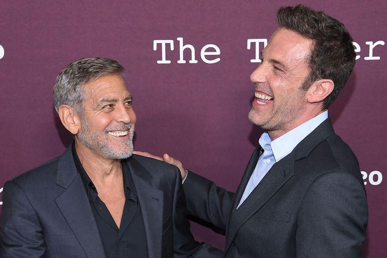 """US actors George Clooney (L) and Ben Affleck arrive for """"The Tender Bar"""" premiere at the Directors Guild of America Theatre in Los Angeles, California, on October 3, 2021. (Photo by LISA O'CONNOR / AFP)"""