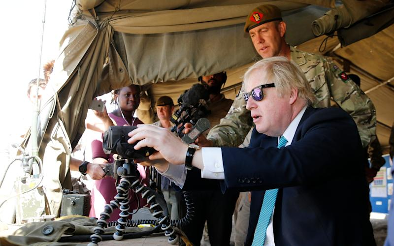 Britain's Foreign Secretary Boris Johnson visits the weapon handling course at the British Army Training Unit Kenya  - Credit: AP