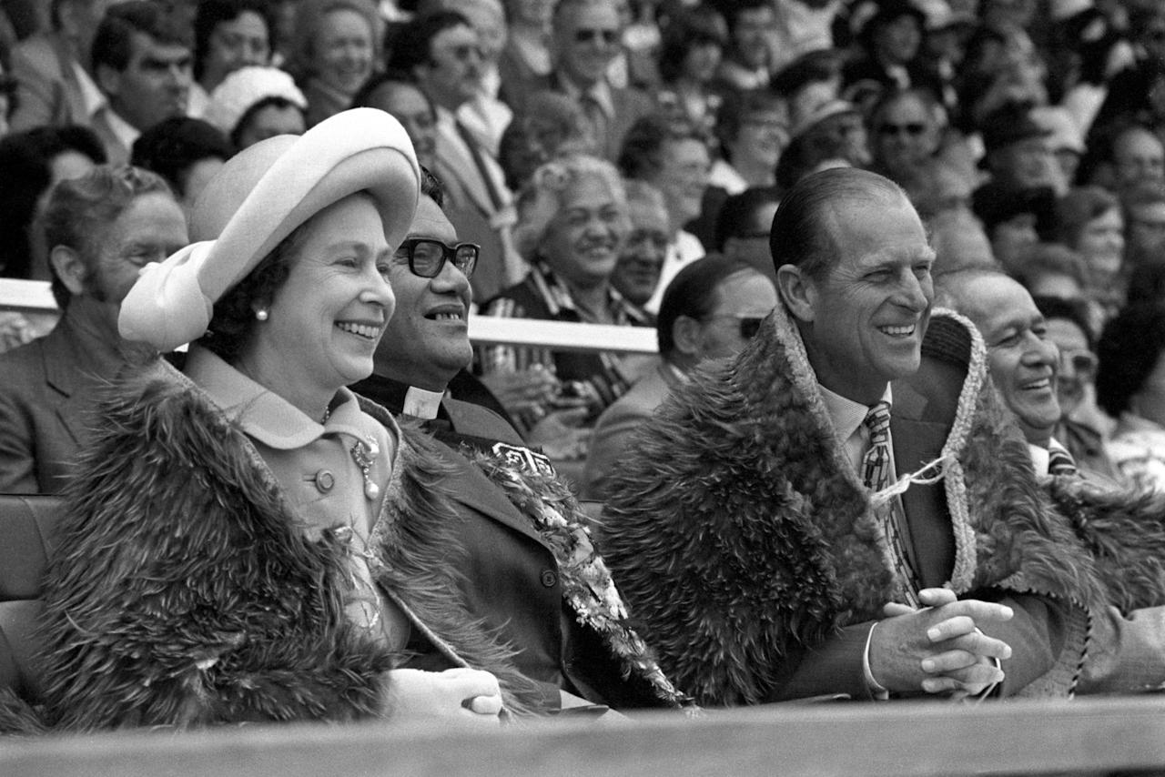 <p>The Queen and the Duke of Edinburgh, both wearing Maori Kahu-Kiwi (Kiwi feather cloaks) at Rugby Park in Gisborne, on the North Island of New Zealand when they attended the opening of the Royal New Zealand Polynesian Festival as their Silver Jubilee Tour continues. </p>