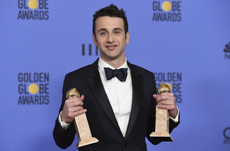 """FILE - This Jan. 8, 2017 file photo shows Justin Hurwitz in the press room with the award for best original song for motion picture for """"City Of Stars"""" and best original score - motion picture for """"La La Land"""" at the 74th annual Golden Globe Awards in Beverly Hills, Calif. For Hurwitz, it's been a long, laborious ride from dreaming up the musical """"La La Land"""" with his old college roommate Damien Chazelle over six years ago to becoming the toast of awards season. He has won a handful of critics' awards, a BAFTA and two Golden Globe Awards and is nominated for three Oscars, one for best score and two for best song. (Photo by Jordan Strauss/Invision/AP, File)"""