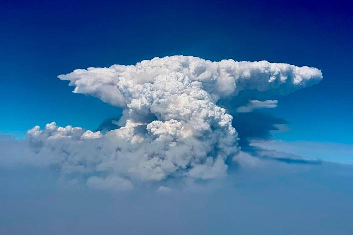 In this photo taken with a drone provided by the Bootleg Fire Incident Command, a pyrocumulus cloud, also known as a fire cloud, rises over the Bootleg Fire in southern Oregon on July 14.