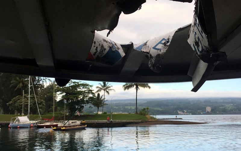 Damage to the roof of a tour boat after an explosion sent lava flying through the roof off the Big Island of Hawaii - Hawaii Department of Land and Natural Resources
