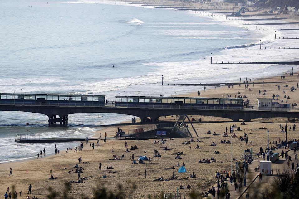 People enjoy the sunshine on Bournemouth beach, Dorset. Picture date: Saturday February 27, 2021.