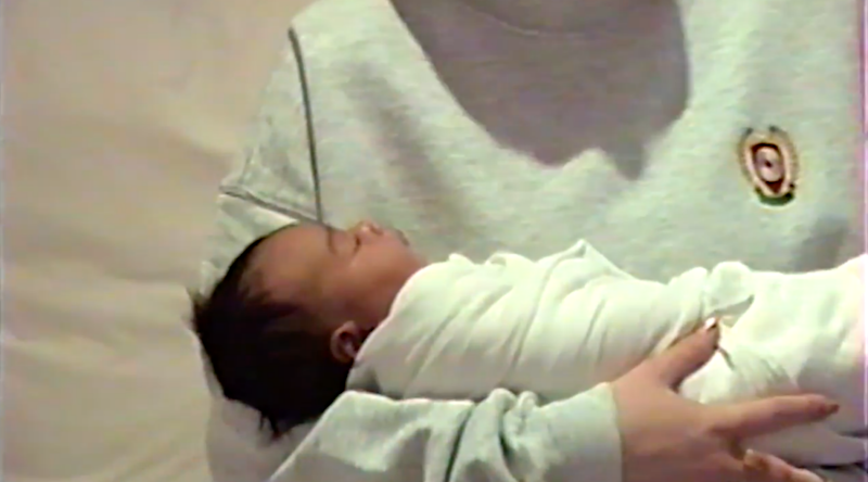 Kylie is handed the baby in the adorable clip. Photo: YouTube/Kylie Jenner
