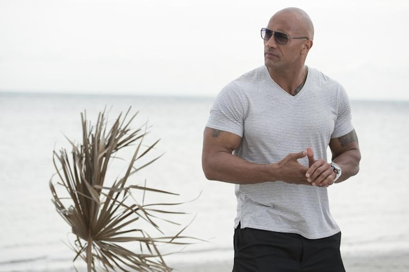 """This image released by HBO shows Dwayne Johnson from the HBO series, """"Ballers."""" Johnson is an entertainment machine. The 44-year-old former pro-wrestler turned global superstar had a 12 month shooting schedule last year, and is on track for another in 2017. It's no wonder he topped Forbes' highest paid actors list in 2016 with an estimated $64.5 million payday. (HBO via AP)"""