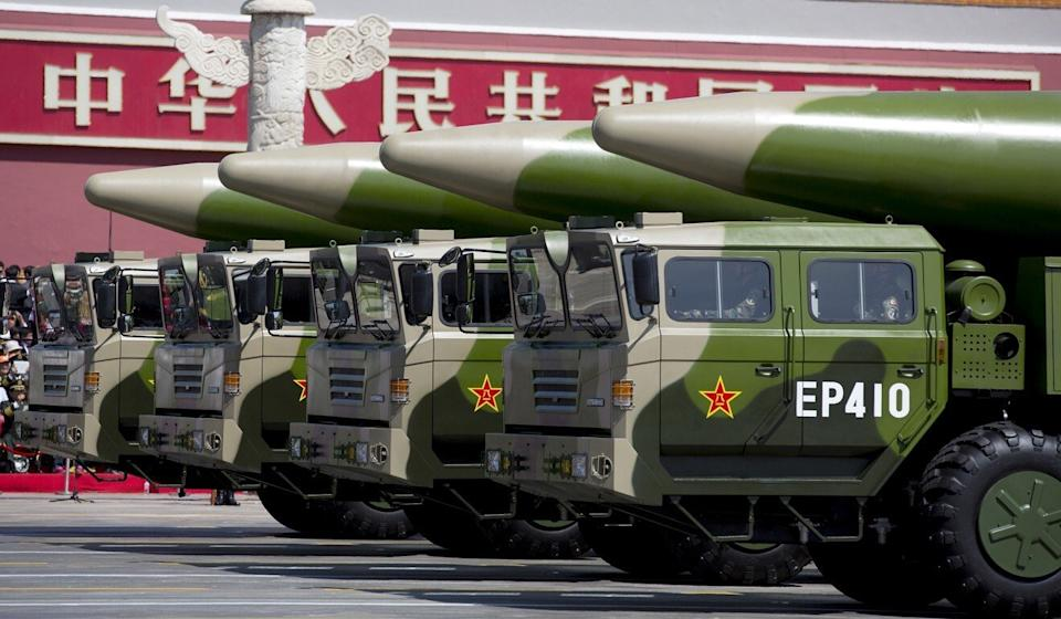 Military vehicles carrying DF-26 ballistic missiles take part in a parade to mark the 70th anniversary of the end of World War II in Beijing in 2015. Photo: Reuters