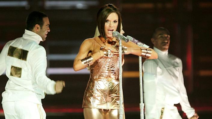 """<ul> <li><strong>Net worth: </strong>$450 million (combined with David Beckham)</li> </ul> <p>While she started her career as a Spice Girl, it's safe to say that most of Victoria Beckham's fortune did not come from touring and recording as Posh Spice. She is a fashion designer, model and businessperson. British Glamour magazine named her woman of the year and entrepreneur of the year, and she has graced the cover of Vogue more than once. Oh, and her husband is retired soccer star David Beckham.</p> <p><em><strong>Read: <a href=""""https://www.gobankingrates.com/net-worth/celebrities/celebrities-who-were-teachers/?utm_campaign=1120407&utm_source=yahoo.com&utm_content=13&utm_medium=rss"""" rel=""""nofollow noopener"""" target=""""_blank"""" data-ylk=""""slk:18 Celebs Who Used To Be Teachers"""" class=""""link rapid-noclick-resp"""">18 Celebs Who Used To Be Teachers</a></strong></em></p> <p><small>Image Credits: Matt Baron / Shutterstock.com</small></p>"""