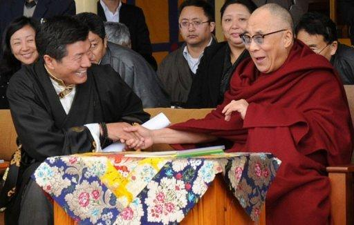 "Tibetan spiritual leader the Dalai Lama (R) shakes hands with Kalon Tripa of the Central Tibetan Administration, Lobsang Sangay in McLeod Gan. Tibet's government-in-exile on Saturday blamed China's ""hardline"" leaders for a string of Tibetan self-immolations as it marked the anniversary of the Dalai Lama's failed revolt against Chinese rule"