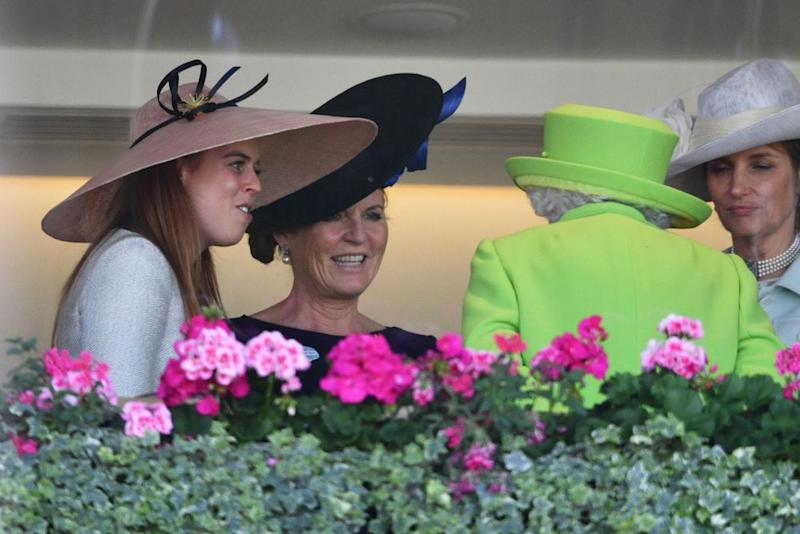 Princess Beatrice (left) and her mom, Sarah Ferguson (center), speak with the Queen at Royal Ascot on June 22, 2018.
