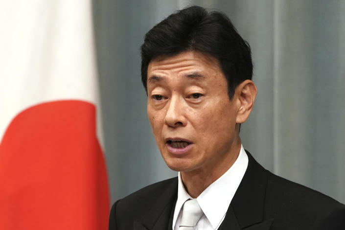 FILE - In this Sept. 11, 2019, file photo, newly appointed Economy and Fiscal Policy Minister Yasutoshi Nishimura speaks during a press conference at the prime minister's official residence in Tokyo. Nishimura, who is in charge of COVID-19 measures, told NHK public television's weekly talk show Sunday, Sept. 12, 2021 that about 60% of the population is expected to be fully vaccinated by the end of September, on par with current levels in Europe. (AP Photo/Eugene Hoshiko, File)