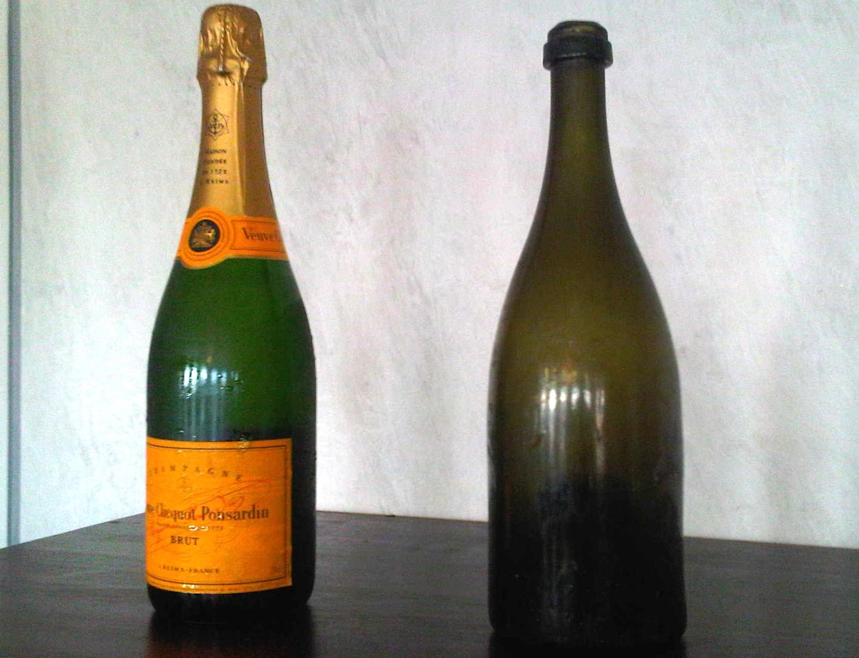 This undated image made available by French Champagne House Veuve Clicquot shows a current bottle of champagne beside one of the 168 bottles of champagne salvaged from a 200-year-old shipwreck in the waters off Aland Islands, between Sweden and Finland, which was opened at a sampling in Mariehamn, Finland on Wednesday Nov. 17, 2010.  (AP Photo/Lehtikuva/Jussi Nukari)