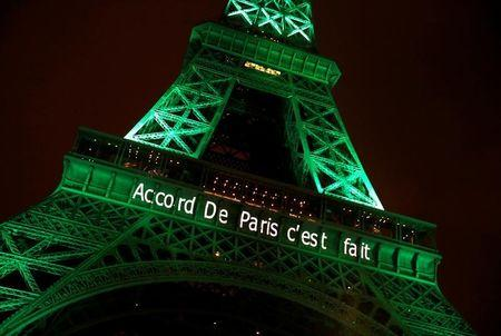 """The Eiffel tower is illuminated in green with the words """"Paris Agreement is Done"""", to celebrate the Paris U.N. COP21 Climate Change agreement in Paris, France, November 4, 2016. REUTERS/Jacky Naegelen"""