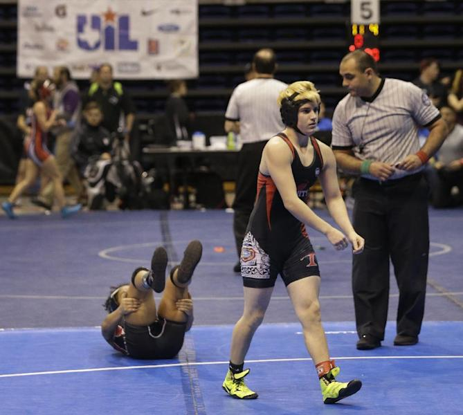 Mack Beggs, right, a transgender wrestler from Euless Trinity, is shown during a quarterfinal against Mya Engert of Amarillo Tascosa during the state wrestling tournament Friday, Feb. 24, 2017, in Cypress, Texas. Beggs was born a female and is transitioning to male but wrestles in the girls division. (Melissa Phillip/Houston Chronicle via AP)