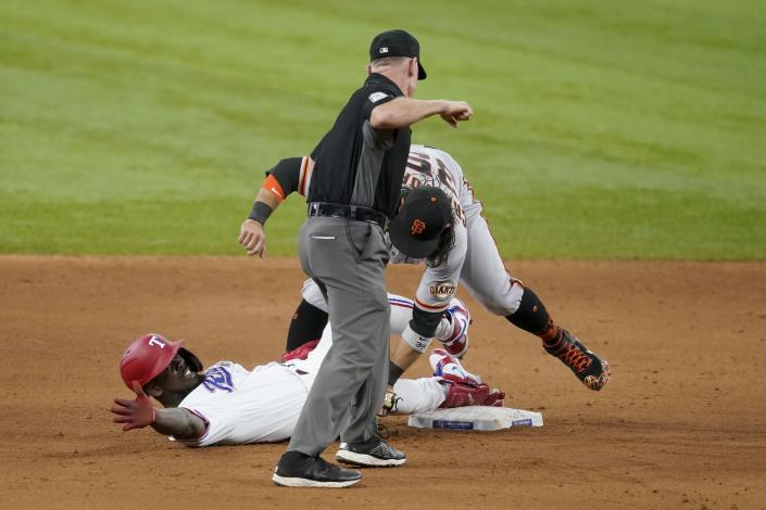 Texas Rangers' Adolis Garcia calls for time, San Francisco Giants' Brandon Crawford keeps the tag on and umpire Lance Barksdale calls Garcia out in the ninth inning of a baseball game in Arlington, Texas, Wednesday, June 9, 2021. The play was upheld after a video review. (AP Photo/Tony Gutierrez)