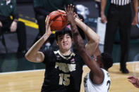 Purdue's Zach Edey, left, looks to shoot against Michigan State's Mady Sissoko during the first half of an NCAA college basketball game Friday, Jan. 8, 2021, in East Lansing, Mich. (AP Photo/Al Goldis)