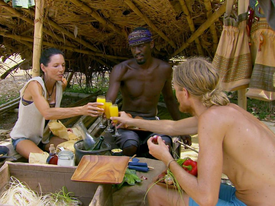Monica Culpepper, Gervase Peterson, and Tyson Apostol eating the final breakfast and clinking glasses on Survivor
