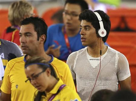 Colombia's track cyclist Edwin Alcibiades Avila Vanegas uses a pair of Beats by Dr. Dre headphones at the Velodrome during the London 2012 Olympic Games