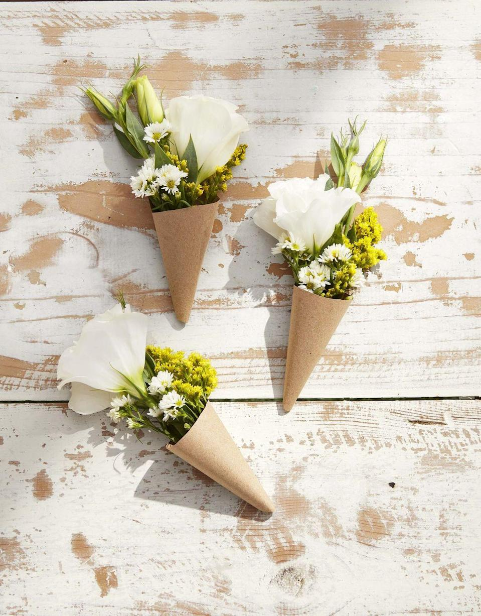 """<p>Scatter mini bouquets around the house so that mom can feel the love wherever she goes. Simply insert garden flowers in kraft paper cones and leave wherever mom frequents – Perched next to her morning cup of coffee would be a great way to start her day!</p><p><a class=""""link rapid-noclick-resp"""" href=""""https://www.amazon.com/Brown-Kraft-Paper-Roll-Wrapping/dp/B082KHMC2Z/ref=sr_1_3_sspa?tag=syn-yahoo-20&ascsubtag=%5Bartid%7C10050.g.2357%5Bsrc%7Cyahoo-us"""" rel=""""nofollow noopener"""" target=""""_blank"""" data-ylk=""""slk:SHOP CRAFT PAPER"""">SHOP CRAFT PAPER</a><br></p>"""