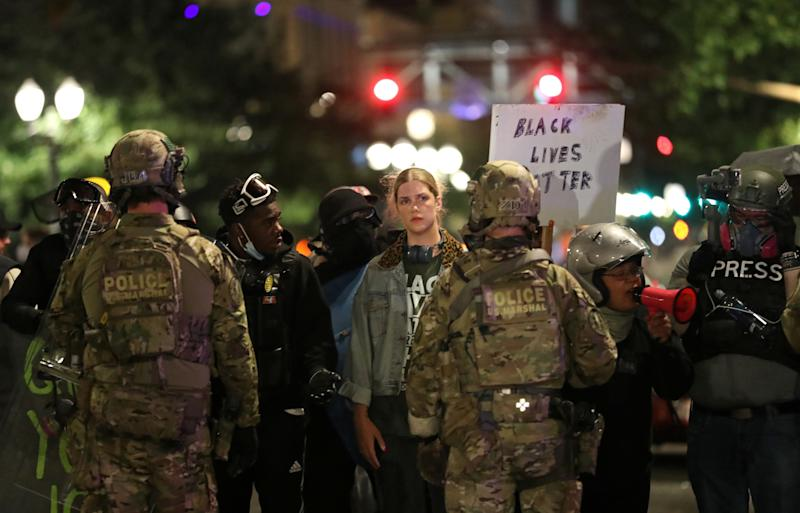 Demonstrators face off federal law enforcement officers during a protest against racial inequality and police violence in Portland, Oregon, U.S., July 25, 2020. (Photo: REUTERS/Caitlin Ochs)