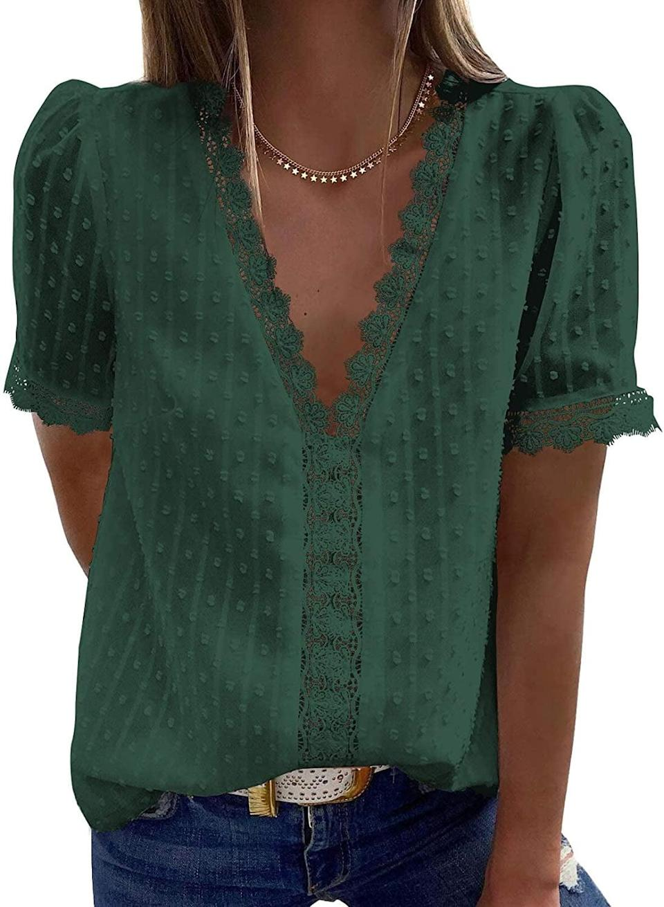 <p>The eye-catching details of this <span>Dokotoo V Neck Lace Crochet Tunic Tank Top</span> ($19) make it stand out.</p>