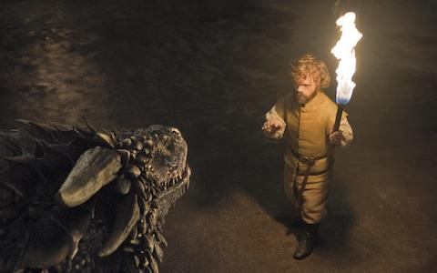 Tyrion Lannister meets an imprisoned dragon in Game of Thrones - Credit: HBO