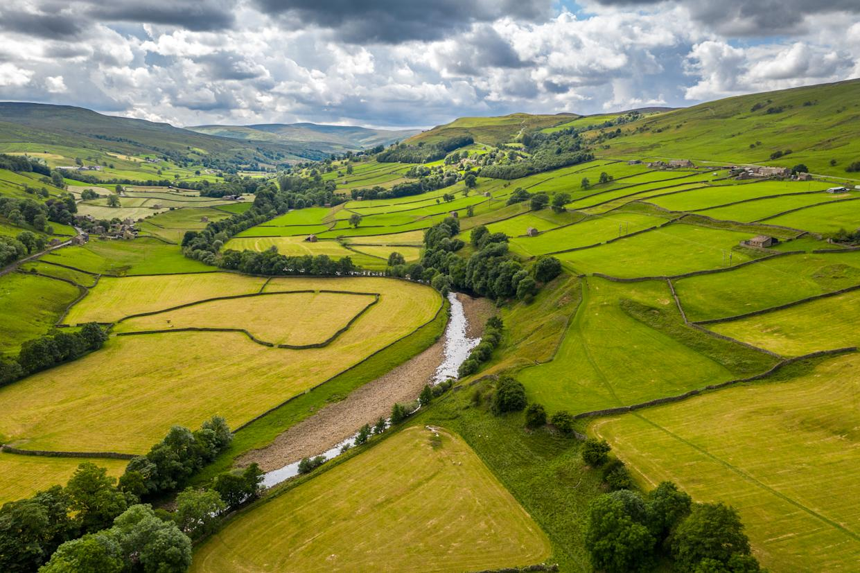 The River Swale snakes through the countryside of Swaledale, Yorkshire.