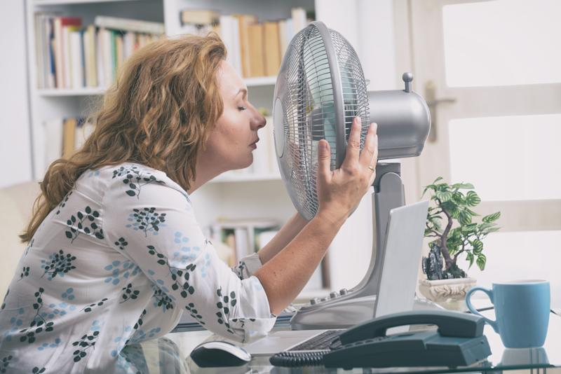 Trying to work in a heatwave is not the best feeling ever. (Getty Images)