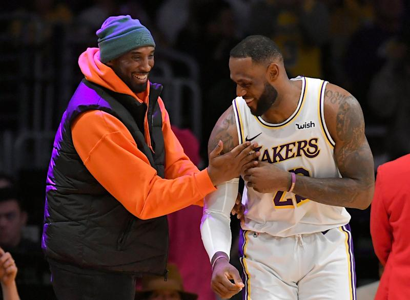<strong>LeBron James with Kobe Bryant on Saturday night.</strong> (Photo: John McCoy via Getty Images)