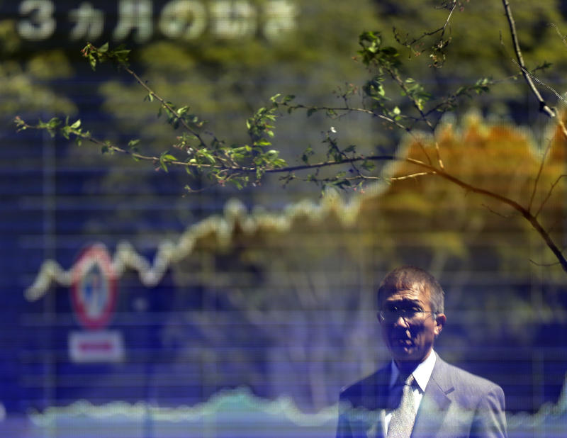 A man looks at an electronic stock board of a securities firm in Tokyo Monday, April 8, 2013 as Japan's Nikkei 225 index rose 258.31 points to 13091.95 at the morning session.  Asian stock markets were mixed Monday amid concerns about tensions on the Korean Peninsula, bird flu in China and a disappointing U.S. jobs report, although the Nikkei piled on more gains as the yen's dramatic fall boosted the country's powerhouse export sector. (AP Photo/Itsuo Inouye)