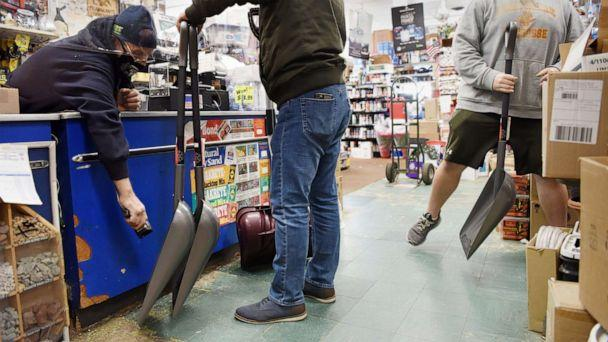 PHOTO: Domenico Pisciotta, left, owner of Meadowlands Hardware, rings up four snow shovels for Rafael Torres, in East Rutherford, N.J., Dec. 15, 2020, a day before a winter storm is due to move into the northeast. (Tariq Zehawi/USA Today Network)