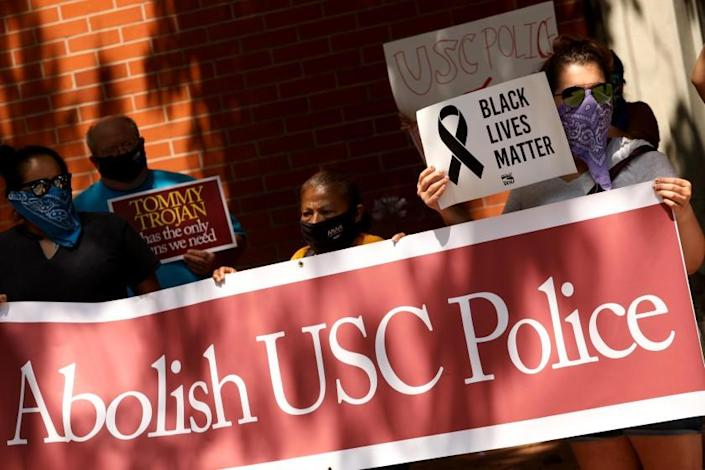 """Protesters rally in front of the USC Department of Public Safety on June 30 demanding that the university abolish the campus police force. <span class=""""copyright"""">(Genaro Molina / Los Angeles Times)</span>"""