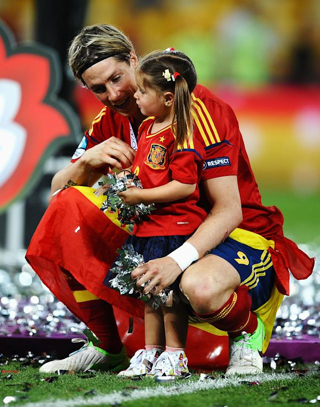KIEV, UKRAINE - JULY 01: Fernando Torres of Spain speaks with his daughter Nora Torres following victory in the UEFA EURO 2012 final match between Spain and Italy at the Olympic Stadium on July 1, 2012 in Kiev, Ukraine. (Photo by Laurence Griffiths/Getty Images)