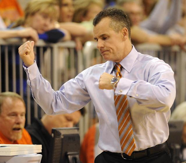 Florida coach Billy Donovan reacts to play on the court during the second half of an NCAA college basketball game against The University of Kansas Tuesday, Dec. 10, 2013 in Gainesville, Fla. Florida won the game 67-61. (AP Photo/Phil Sandlin)