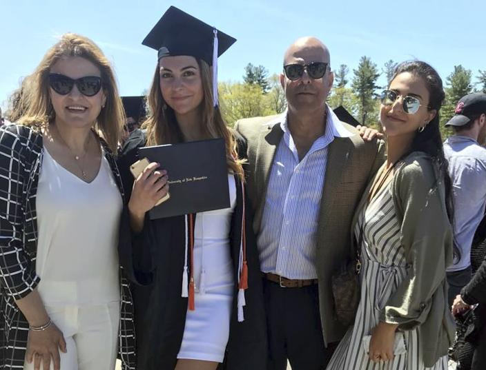 In this May 2019 file photo provided by Guila Fakhoury, her father Amer Fakhoury, second right, gathers with family members at the University of New Hampshire in Durham, N.H. U.S. Sen. Jeanne Shaheen, of New Hampshire, is sponsoring a bill, which she is expected to introduce Monday, Feb. 24, 2020, along with Republican Sen. Ted Cruz of Texas, to ban visas and freeze assets of Lebanese officials involved in the detention of Amer Fakhoury. Fakhoury, a restaurant owner in Dover, New Hampshire, who became a U.S. citizen last year, has been jailed since Sept. 12, 2019, in his native country and has been hospitalized with stage 4 lymphoma. (Guila Fakhoury via AP, File)