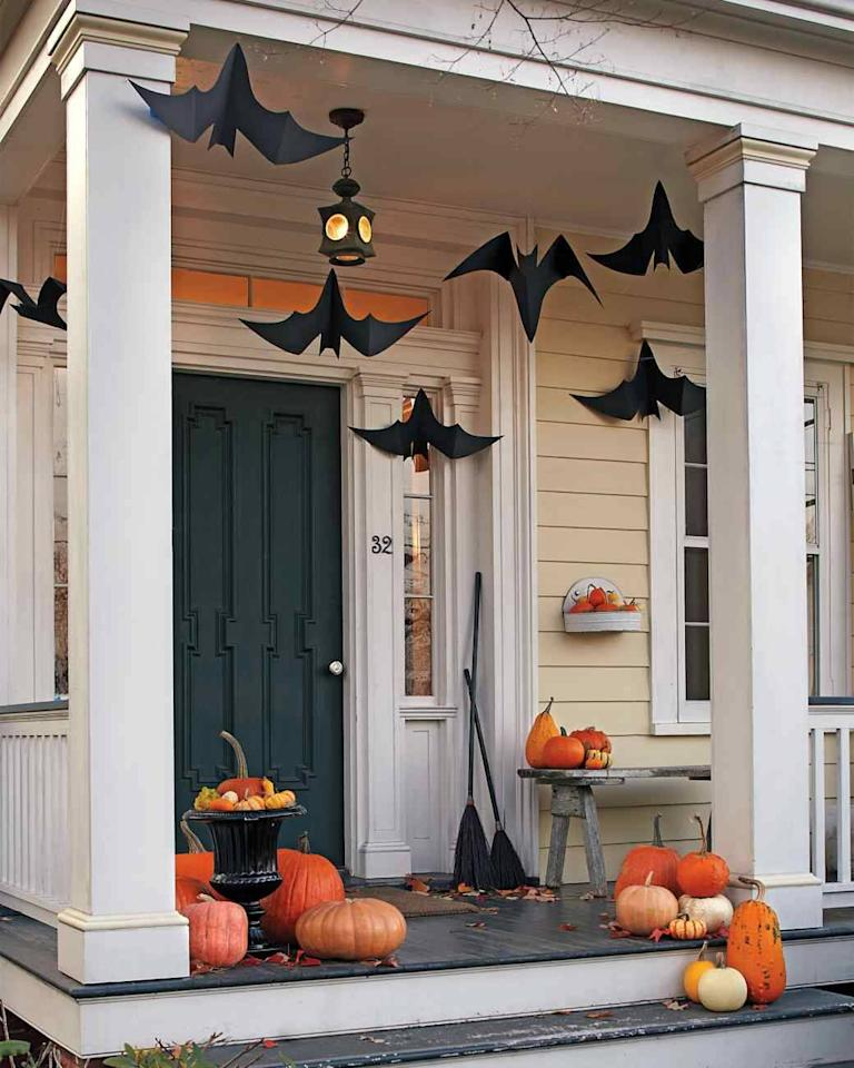 """<p>Using<a href=""""http://www.marthastewart.com/852559/hanging-bats"""">this template</a> from Martha Stewart, making these hanging bats is a cinch! Trust us, this will be much easier than wrangling the real thing. <i>(Photo: Martha Stewart)</i></p>"""
