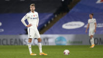 Leeds United's Patrick Bamford reacts after Crystal Palace scored their fourth goal during the English Premier League soccer match between Crystal Palace and Leeds United at the Selhurst Park stadium in London, England, Saturday, Nov. 7, 2020. (Naomi Baker/Pool via AP)
