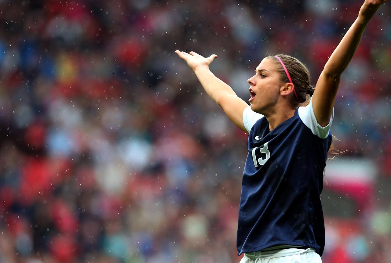 MANCHESTER, ENGLAND - JULY 31:  Alex Morgan of United States reacts during the Women's Football first round Group G match between the United States and DPR Korea,on Day 4 of the London 2012 Olympic Games at Old Trafford on July 31, 2012 in Manchester, England.  (Photo by Stanley Chou/Getty Images)