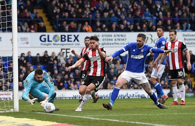 "Soccer Football - Championship - Ipswich Town vs Sheffield United - Portman Road, Ipswich, Britain - March 10, 2018 Ipswich's Luke Chambers in action with Sheffield United's George Baldock Action Images/Alan Walter EDITORIAL USE ONLY. No use with unauthorized audio, video, data, fixture lists, club/league logos or ""live"" services. Online in-match use limited to 75 images, no video emulation. No use in betting, games or single club/league/player publications. Please contact your account representative for further details."