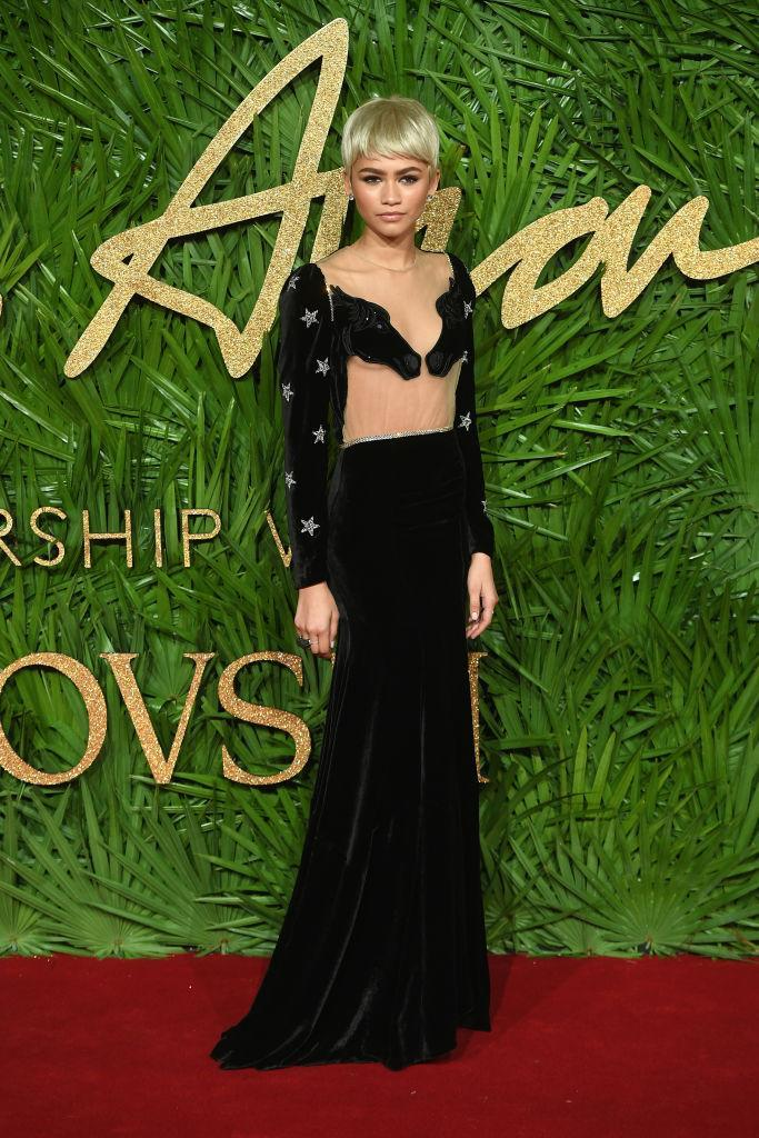 <p>Zendaya sported a blonde pixie cut at the annual Fashion Awards. She chose a horse-emblazoned sheer gown by label of the moment Vivetta for the red carpet. <em>[Photo: Getty]</em> </p>