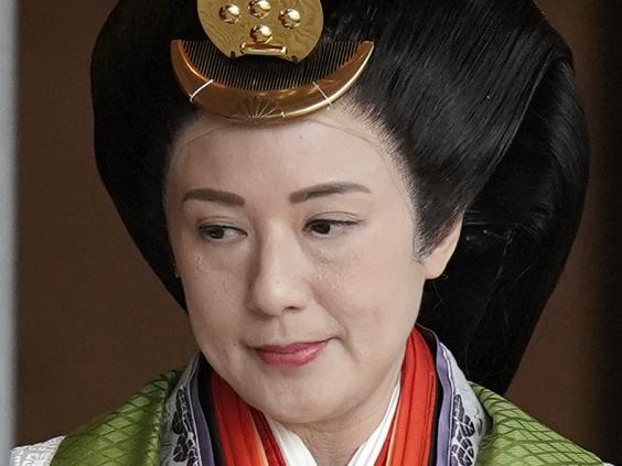 Japan's Empress Masako sat next to her husband during the ceremony (Getty Images)
