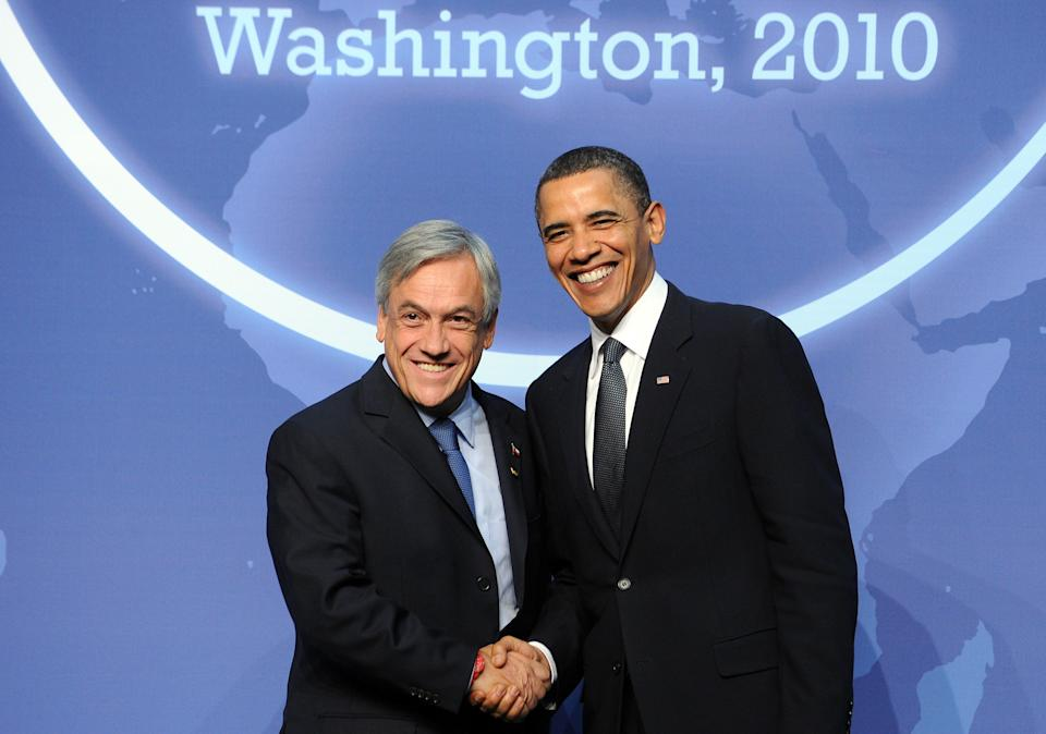 U.S. President Barack Obama greets Chilean President Sebastian Pinera before a dinner at the Washington Convention Center during the Nuclear Security Summit in Washington, D.C., on April 12, 2010.