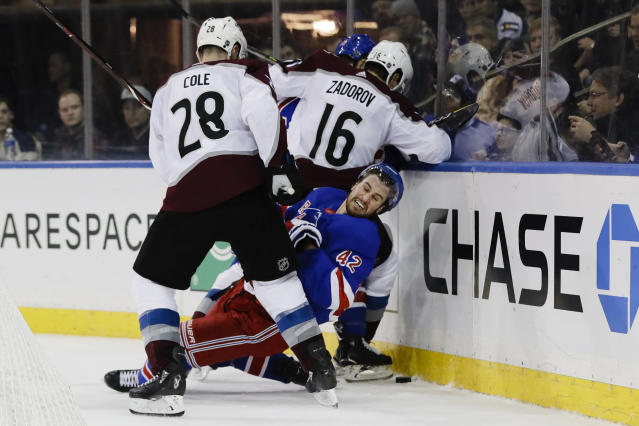 Colorado Avalanche's Ian Cole (28) checks New York Rangers' Brendan Smith (42) during the second period of an NHL hockey game Tuesday, Jan. 7, 2020, in New York. (AP Photo/Frank Franklin II)