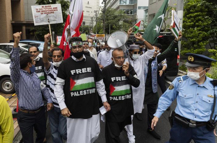 Group of Muslims from different countries and living in Japan march towards the Israeli Embassy in Tokyo on Friday, May 21, 2021, against they protest against the recent Israeli Palestinian conflict in Gaza. (AP Photo/Hiro Komae)