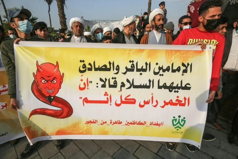 Shiite Muslim clerics from a group calling itself Tajammu' Shabab al-Sharia (Sharia Youth Rally) march with a banner quoting Shiite Imams Baqir and Sadiq as saying that alcohol is the root of all sin, during a demonstration in Baghdad this month